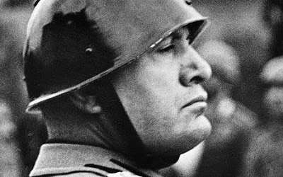 Profile of Mussolini in helmet