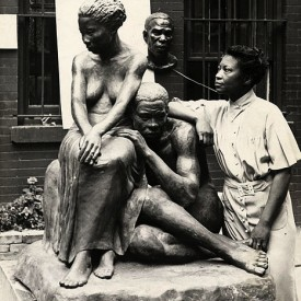 August Savage, circa 1938, with some of her sculptures.