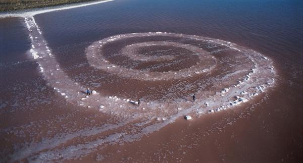 aerial photo of environmental artwork - spiral sand in ocean