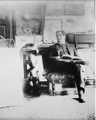 black and white photo of Guillaume Apollinaire in his friend Picasso's studio, 1910.