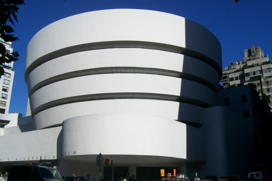 Stark shadows delineate the curving architecture of the Guggenheim Museum in NYC, against a crisp sky.