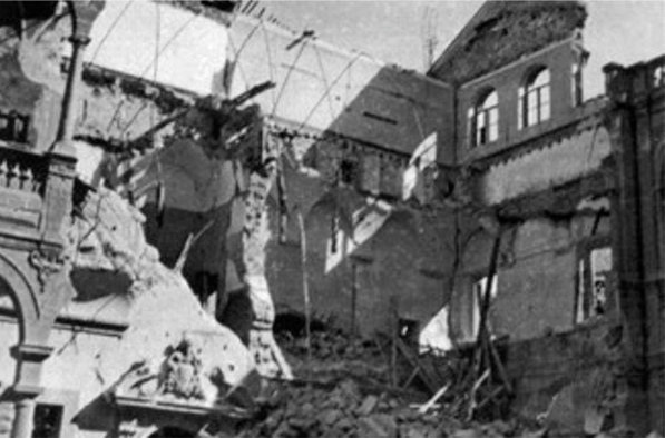 Freestanding walls and unstable portions of buildings amid rubble