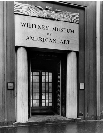 Whitney Museum's front door, flanked by columns and topped by frieze of eagle.