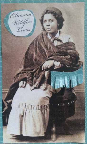 Seated Lewis, wrapped in shawl and 19th century clothes.