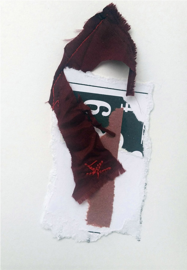 Arrow shape made of fabric, sewn onto ripped papers