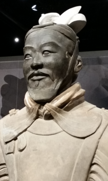 Terra cotta general, with emblematic hat and uniform, looks proudly into distance.