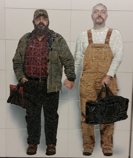 Glittering subway wall mosaic of two serious-looking bearded men holding hands while looking at viewer.
