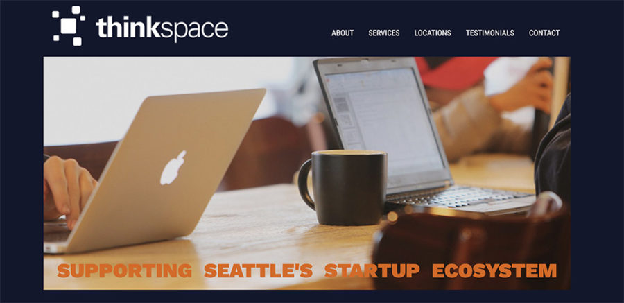 Homepage for thinkspace, featuring people working at shared tabletop with laptops and coffee mugs.